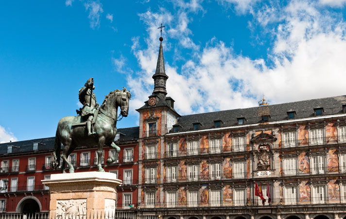 The equestrian bronze statue of King Philip III riding his horse standing prominently in the middle of Plaza Mayor, Madrid.